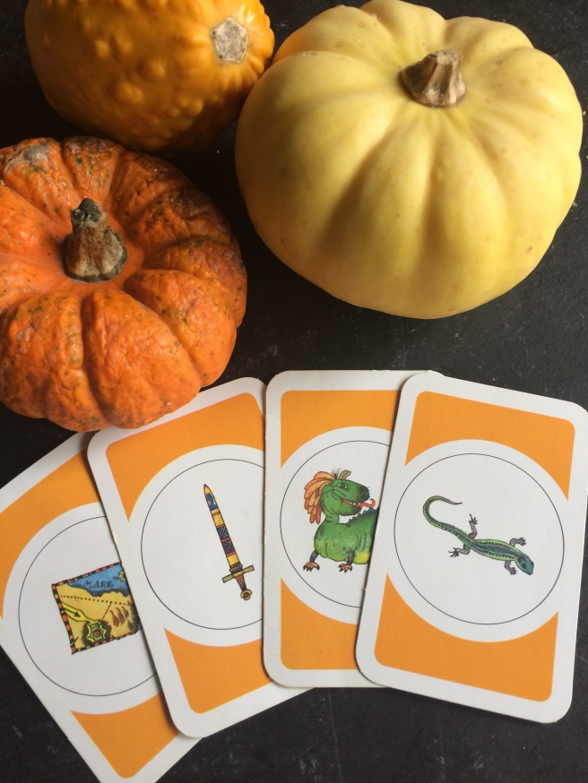 A picture of gourds and four cards from The Labyrinth board game